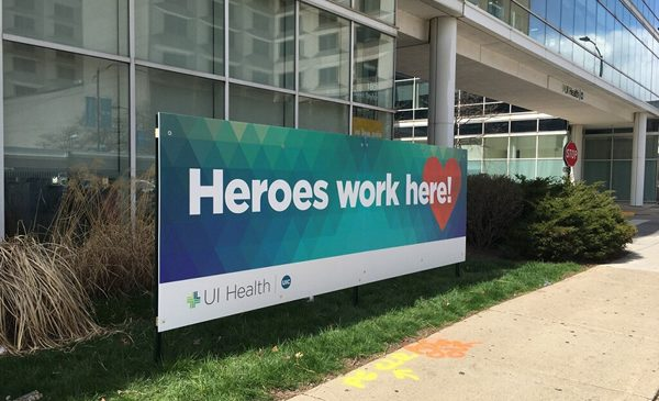 Heroes work here signage.